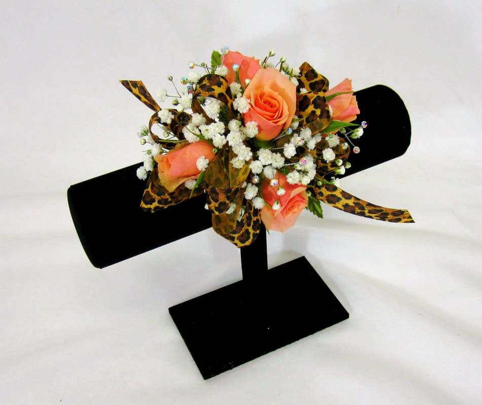 Coral rose corsage with cheeta ribbon