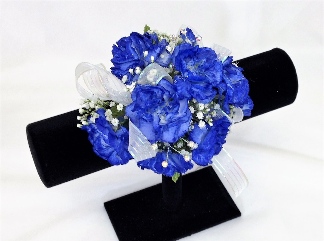 Blue mini carnation corsage