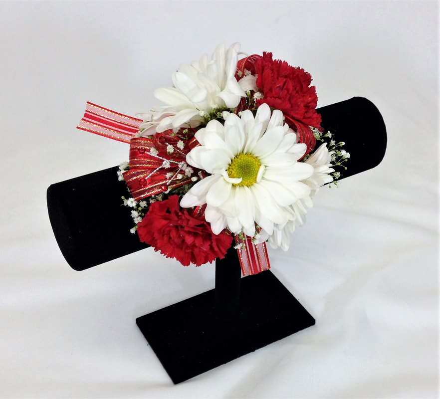 White daisy and Red Mini Carn corsages