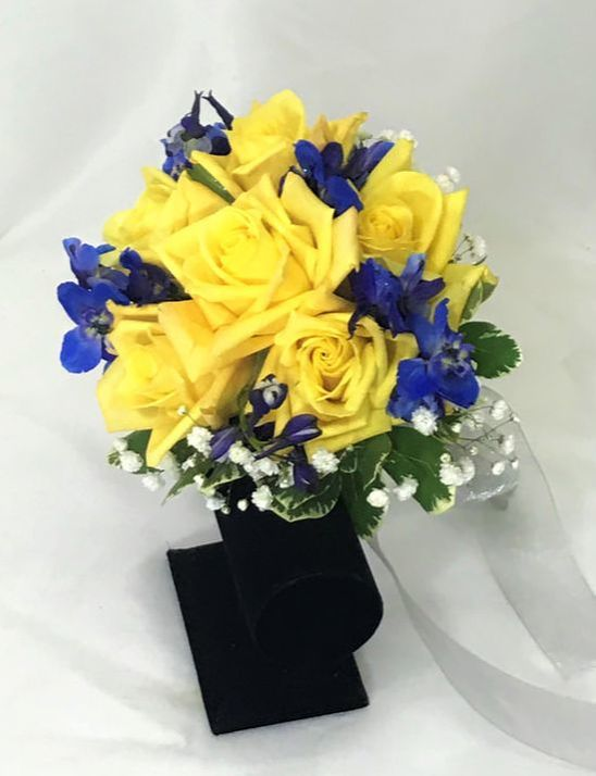 Yellow rose and blue delph hand tied bouquet