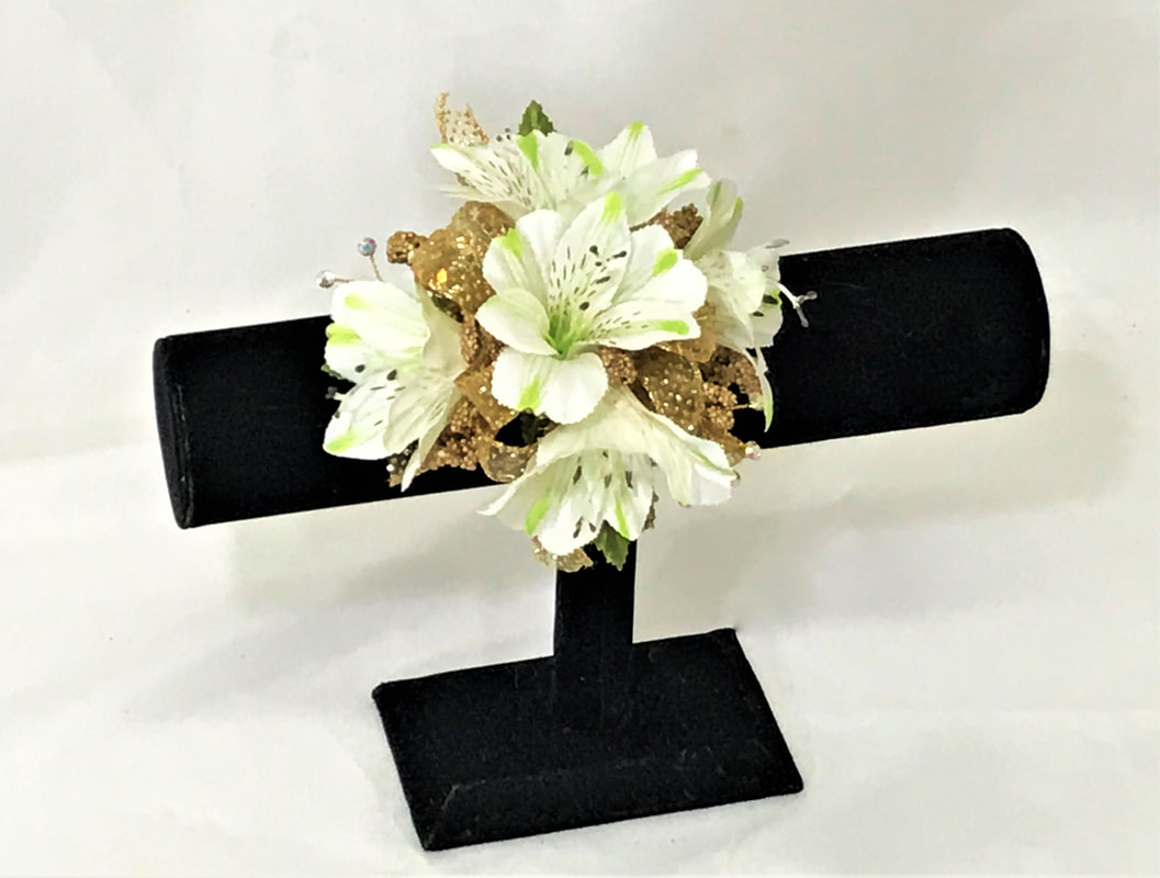 White Alstro corsage with gold ribbon