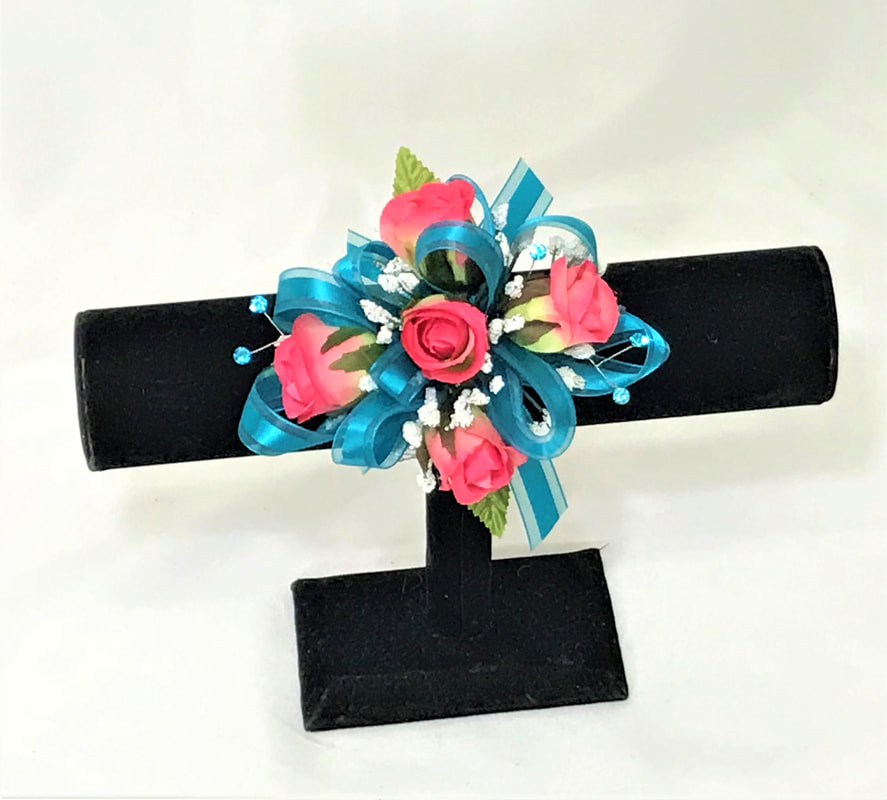 Hot Pink rose corsage with teal ribbon