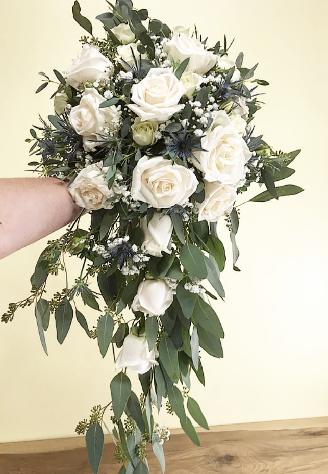 Bridal bouquet white roses and euc