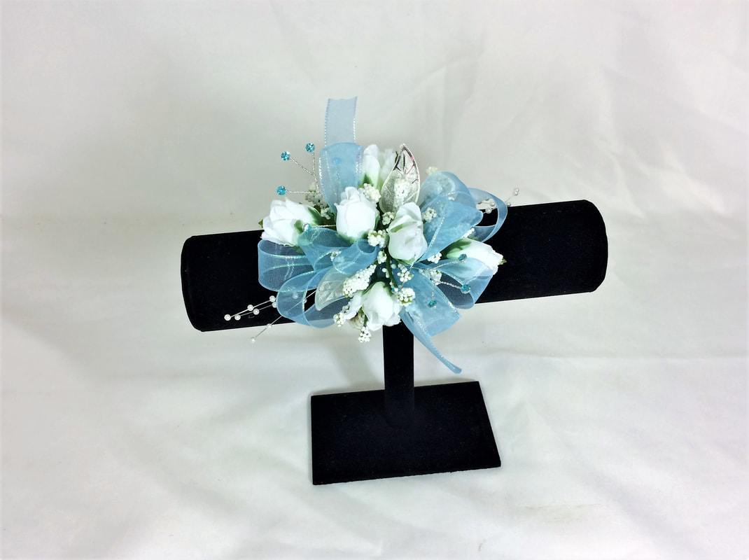 White rose wristlet with aqua ribbon