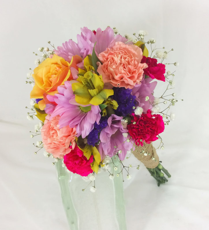 Brightly colored bridesmaids bouquets