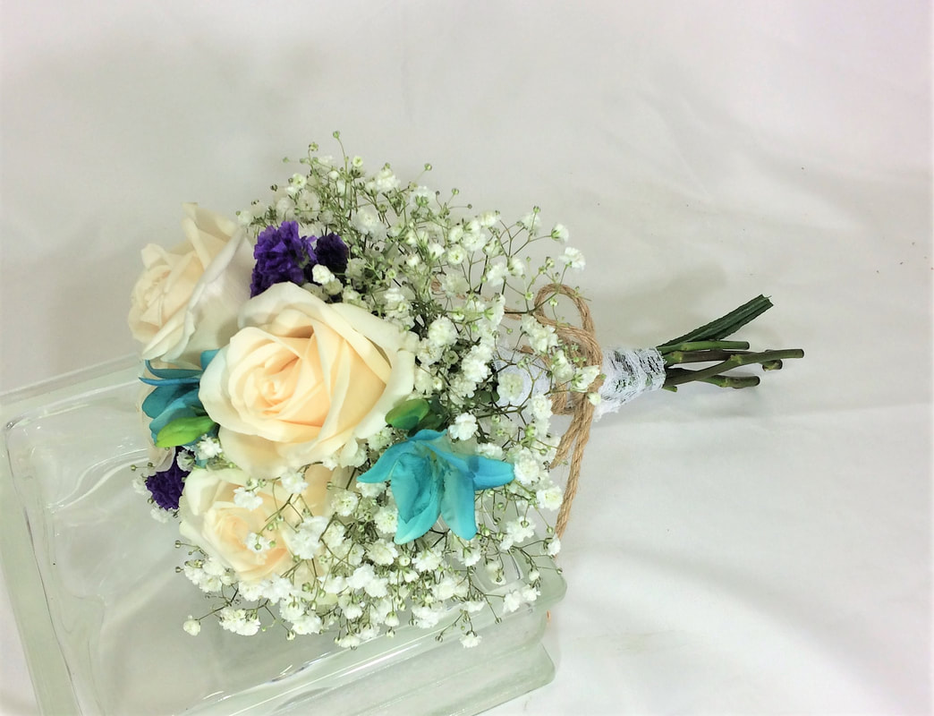Hand tied rose & freesia bouquet
