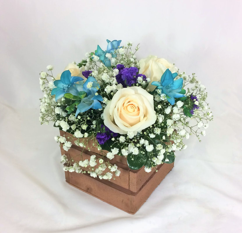 White rose and Freesia Centerpiece in crate