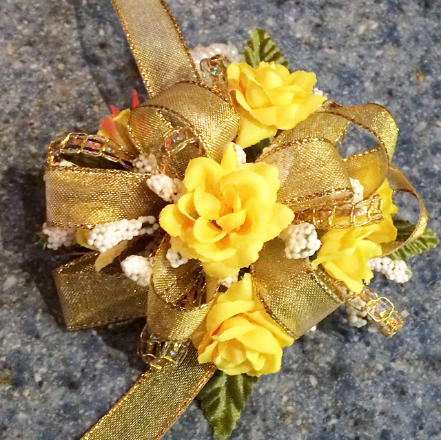 Yellow rose wristlet with gold bow
