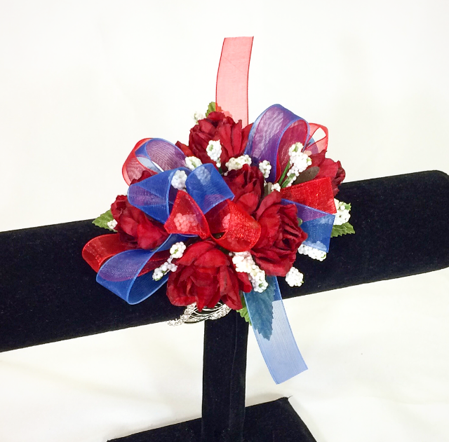 Red rose wristlet with a red & blue bow