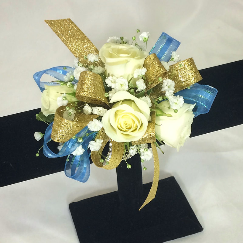 White rose wristlet with gold and blue bow