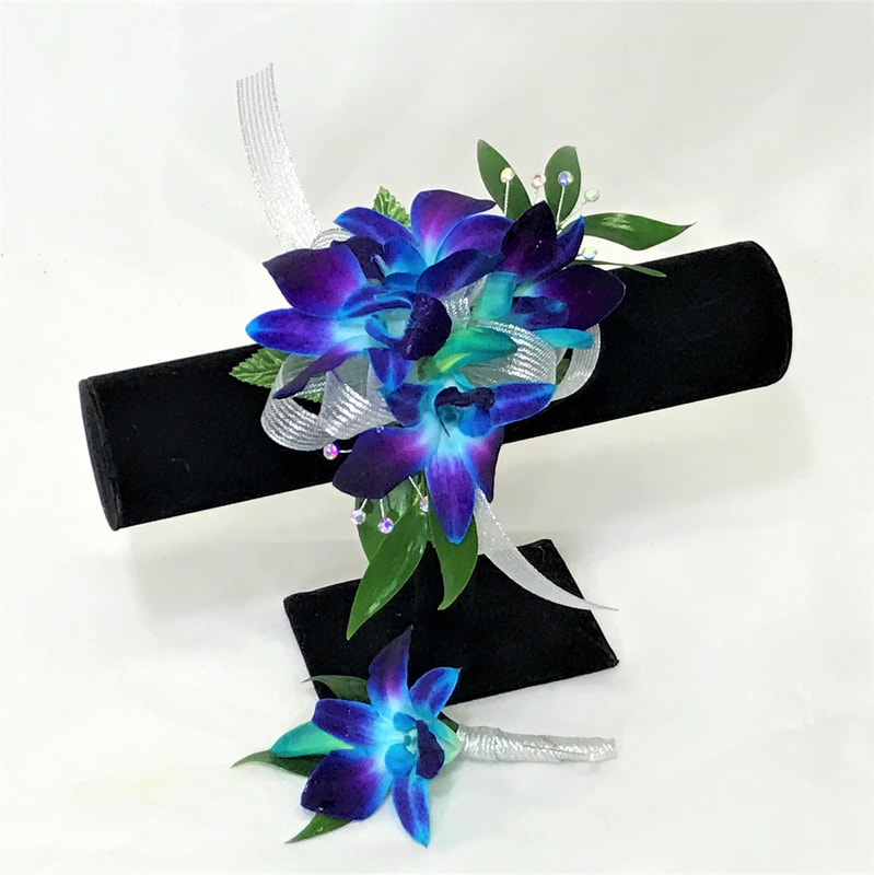 Blue orchid corsage and bout with silver ribbon