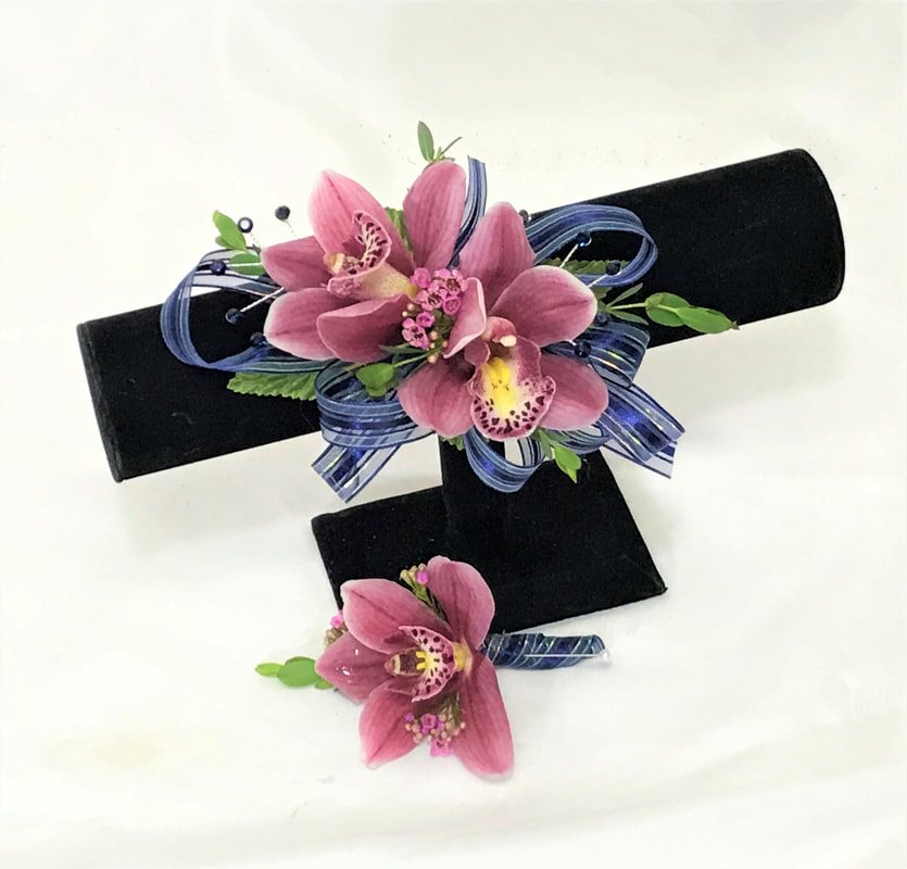 Pink orchid corsage and boutonniere