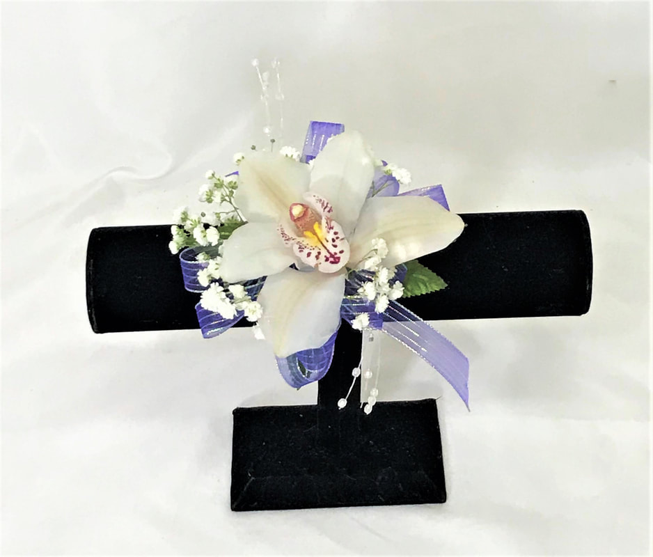 Single white orchid corsage